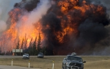 Wildfires Disrupt Oil Sands, Exposing Climate Risk