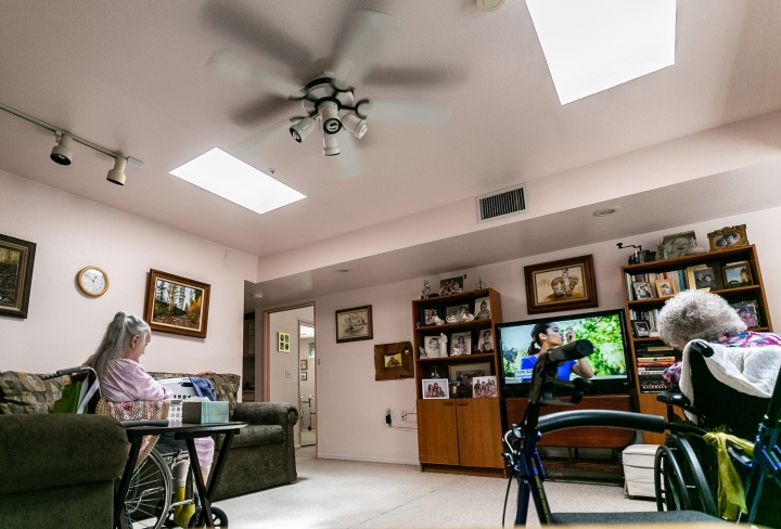 Residents Watch Television Under A Cooling Breeze From Ceiling Fan At The Waverly House Care Home In Historic Catalina Vista Neighborhood On